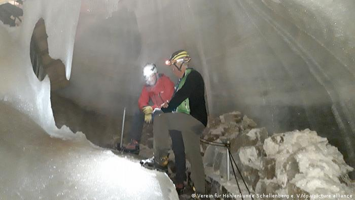 Two climbers in the Ice Cave in Schellenberg, Bavaria, Germany