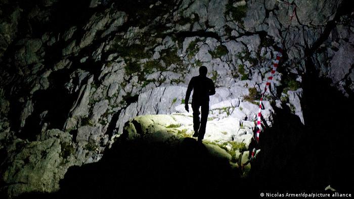 Man walking in the Riesending pit cave in Untersberg, Germany