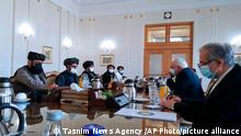 FILE - In this file photo released Sunday, Jan. 31, 2021, by Tasnim News Agency, Iran's Foreign Minister Mohammad Javad Zarif, second right, meets with a Taliban political team, in Tehran, Iran. The Taliban have been on a diplomatic blitz since peace talks with the Afghan government stalled in Qatar in January and the Biden administration said it plans to review a U.S.-Taliban agreement signed last February. Taliban visits to Iran and Moscow, and a planned trip to Turkey — come as the Afghan government's negotiating team warned that if the Taliban fail to resume the talks, the government could recall its team from Doha before a deal is reached. (Tasnim News Agency via AP, File)