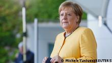 German Chancellor Angela Merkel waits for leaders arriving atthe G20 Compact with Africa (CwA) meeting in Berlin, Germany, August 27, 2021. REUTERS/Michele Tantussi