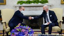 President Joe Biden shakes hands with Israeli Prime Minister Naftali Bennett as they meet in the Oval Office of the White House, Friday, Aug. 27, 2021, in Washington. (AP Photo/Evan Vucci)