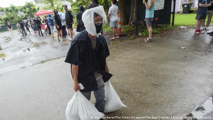 A person carries sandbags