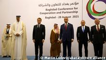 (L to R) Qatar's Emir Sheikh Tamim al-Thani, French President Emmanuel Macron, Saudi Foreign Minister Faisal bin Farhan, Iraq's Prime Minister Mustafa al-Kadhemi, Turkey's Foreign Minister Mevlut Cavusoglu, and Jordan's King Abdullah II pose for a group picture after the meeting in Baghdad on August 28, 2021. (Photo by Ludovic MARIN / POOL / ABACAPRESS.COM