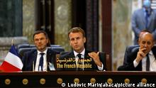 French President Emmanuel Macron speaks, accompanied by French Foreign Affairs Minister Jean-Yves Le Drian (R), during the Baghdad conference in the Iraqi capital on August 28, 2021. (Photo by Ludovic MARIN / POOL / ABACAPRESS.COM