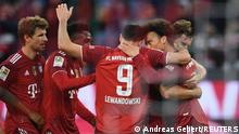 Soccer Football - Bundesliga - Bayern Munich v Hertha BSC - Allianz Arena, Munich, Germany - August 28, 2021 Bayern Munich's Robert Lewandowski celebrates scoring their fourth goal with teammates REUTERS/Andreas Gebert DFL regulations prohibit any use of photographs as image sequences and/or quasi-video.