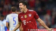 Bayern Munich's Polish forward Robert Lewandowski celebrates scoring the 5-0 and his hattrick during the German first division Bundesliga football match between FC Bayern Munich and Hertha BSC Berlin in Munich, southern Germany, on August 28, 2021. - DFL REGULATIONS PROHIBIT ANY USE OF PHOTOGRAPHS AS IMAGE SEQUENCES AND/OR QUASI-VIDEO (Photo by CHRISTOF STACHE / AFP) / DFL REGULATIONS PROHIBIT ANY USE OF PHOTOGRAPHS AS IMAGE SEQUENCES AND/OR QUASI-VIDEO (Photo by CHRISTOF STACHE/AFP via Getty Images)