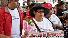 epa04675464 Blanca Luz Nava Velez (C) holds a sign with a photo of her missing son, Jorge Alvarez Nava, one of the 43 Mexican missing students who are presumed dead in Guerrero State, Mexico, as they march through downtown Los Angeles along with 'Caravana 43', in Los Angeles, California, USA, 22 March 2015. Caravan 43 is a group of parents of some of the 43 students who went missing in Guerrero State, Mexico, in September 2014. EPA/STUART PALLEY ++ +++ dpa-Bildfunk +++