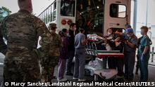 U.S. Soldiers, Airmen and civilian staff receive casualties who were injured outside of Hamid Karzai International Airport and evacuated to the U.S. Army-operated Landstuhl Regional Medical Center (LRMC) for further care in Landstuhl, Germany August 27, 2021. Picture taken August 27, 2021. Landstuhl Regional Medical Center/Marcy Sanchez/Handout via REUTERS THIS IMAGE HAS BEEN SUPPLIED BY A THIRD PARTY.