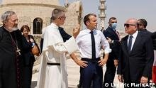 29/08/2021*** French President Emmanuel Macron (C-R) tours the Our Lady of the Hour Church in Iraq's second city of Mosul, in the northern Nineveh province, on August 29, 2021. (Photo by Ludovic MARIN / AFP)