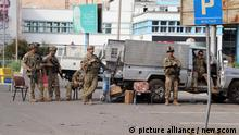 24/08/2021*** Soldiers of U.S. Marine Corps guarding during an evacuation at Hamid Karzai International Airport in Kabul, Afghanistan, Afghanistan on Tuesday, August. 24, 2021. Photo by Bashir Darwish/ UPI Photo via Newscom picture alliance