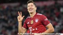 Bayern's Robert Lewandowski celebrates after scoring his side's fifth goal during the German Bundesliga soccer match between Bayern Munich and Hertha Berlin at the Allianz Arena stadium in Munich, Germany, Saturday, Aug. 28, 2021. (AP Photo/Matthias Schrader)