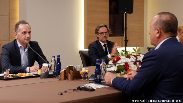 Germany's Foreign Minister Heiko Maas speaks with Turkey's Cavusoglu