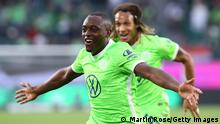 WOLFSBURG, GERMANY - AUGUST 29: Jerome Roussillon of VfL Wolfsburg celebrates after scoring their sides first goal during the Bundesliga match between VfL Wolfsburg and RB Leipzig at Volkswagen Arena on August 29, 2021 in Wolfsburg, Germany. (Photo by Martin Rose/Getty Images)