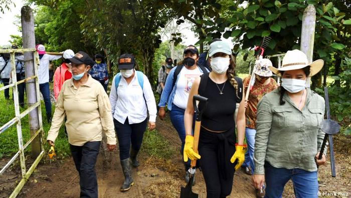 Men and women outdoors wearing face masks