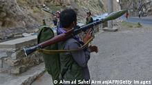 Afghan resistance movement and anti-Taliban uprising forces personnel patrol along a road in Rah-e Tang of Panjshir province on August 29, 2021. - Panjshir -- famous for its natural defences never penetrated by Soviet forces or the Taliban in earlier conflicts -- remains the last major holdout of anti-Taliban forces led by Ahmad Massoud, son of the famed Mujahideen leader Ahmed Shah Massoud. (Photo by Ahmad SAHEL ARMAN / AFP) (Photo by AHMAD SAHEL ARMAN/AFP via Getty Images)