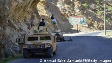 Afghan resistance movement and anti-Taliban uprising forces rest while deployed to patrol along a road at the Rah-e Tang in Panjshir province on August 25, 2021 following Taliban's military takeover of Afghanistan. (Photo by Ahmad SAHEL ARMAN / AFP) (Photo by AHMAD SAHEL ARMAN/AFP via Getty Images)