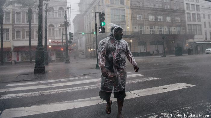 A person crossing the road in New Orleans during Hurricane Ida.