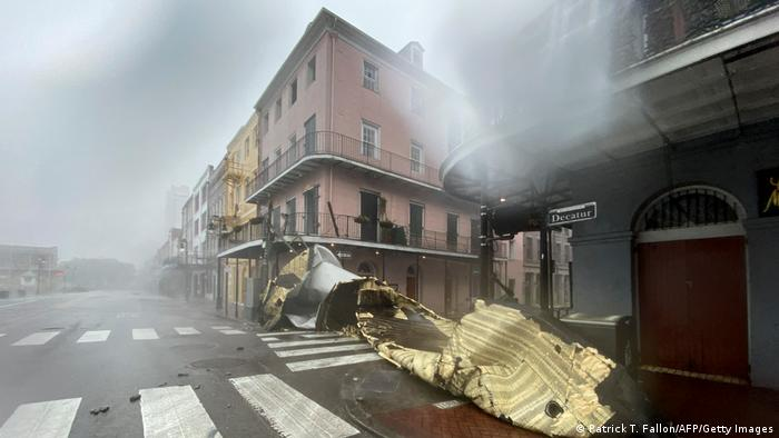 A piece of roof lying on the ground on a street in New Orleans.