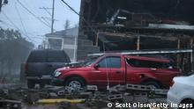 NEW ORLEANS, LOUISIANA - AUGUST 29: Vehicles are damaged after the front of a building collapsed during Hurricane Ida on August 29, 2021 in New Orleans, Louisiana. Ida made landfall earlier today southwest of New Orleans. (Photo by Scott Olson/Getty Images)