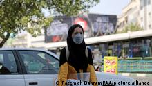 11.8.2021, Teheran, Iran, TEHRAN, IRAN - AUGUST 11: People wear face masks as a measure against coronavirus (Covid-19) pandemic in their daily lives at Enqelab Square in Tehran, Iran during the mourning month of Muharram-ul-Haram on August 11, 2021. Iran on Monday recorded the highest single-day deaths and infections from coronavirus since the outbreak last year, as the Delta variant drives the fifth wave of the pandemic. The Middle East's worst-hit country recorded 588 deaths, the highest single-day figure since February 2020, taking the overall fatalities to 94,603, the health ministry said. Muharram is known as the first month of the Islamic calendar in which Shiite Muslims will hold mourning processions on November 4 to observe Ashura, the 10th day of Muharram, the mark the martyrdom of Prophet Mohammad's grandson Imam Hussein, killed in a battle in Karbala in Iraq in 680 AD. Fatemeh Bahrami / Anadolu Agency