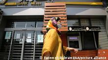 16.8.2021, Teheran, Iran, TEHRAN, IRAN - AUGUST 16: A woman wears a face mask as shops remain closed due to coronavirus (COVID-19) measures and Muharram events continue in Tehran, Iran on August 16, 2021. Shops remain closed at Valiasr Street, Jumhuri Street, Grand Bazaar and other main streets. Fatemeh Bahrami / Anadolu Agency