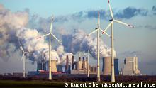 Wind turbines in front of a coal plant in Germany