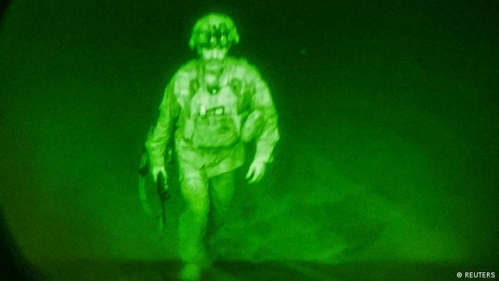 US soldier steps on a plane ramp, photo taken using night vision optics