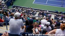 Tennis fans watch play between Madison Keys, of the United States, and Sloane Stephens, of the United States, during the first round of the US Open tennis championships, Monday, Aug. 30, 2021, in New York. (AP Photo/Seth Wenig)