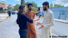 Description: Afghan refugee Khanbic Sadiq and his relative talk about escaping Afghanistan and their temporary home Albania with DW's correspondent Fanny Facsar (Photo: Elona Elezi/DW, 30th of August, 2021. Tirana/Albania)