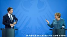 German Chancellor Angela Merkel, right, and Austria's Chancellor Sebastian Kurz brief the media prior to a meeting at the chancellery in Berlin, Germany, Tuesday, Aug. 31, 2021. (AP Photo/Markus Schreiber, Pool)