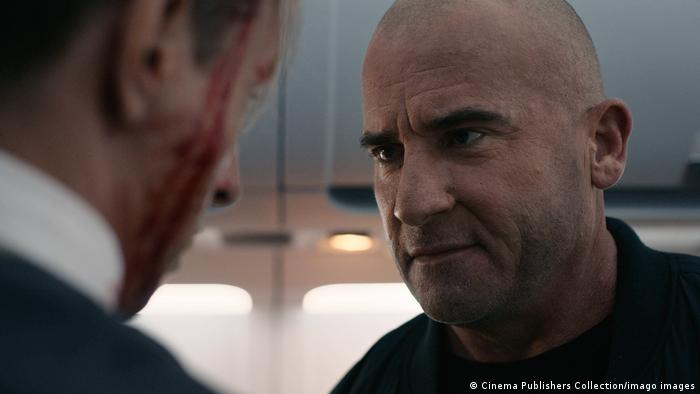 A still from Blood Red Sky featuring Dominic Purcell talking to someone.