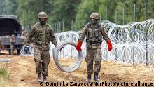 Poland Erects A Border Between Belarus And The EU Polish Army Soldiers build a fence with concertina wire at the Belarusian border in order to stop immigrants from entering the country in Krynki, Poland on 27 August, 2021. In August only more than 2000 immigrants entered Poland from Belarus. The Polish government decided to build a fence to put a stop to an influx of migrants walking across the Belarus border. The border between Belarus and Poland is also the border of the European Union. Poland accuses the Lukashenko regime of orchestrating the transit of thousands of migrants from the Middle East to put pressure on the EU. (Photo by Dominika Zarzycka/NurPhoto)