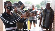 21.08.2021 In this Aug. 21, 2021, image taken from video, firearms instructor Wayne Thomas instructs women the proper stance in firearms shooting at the Recoil Firearms store in Taylor, Mich. About 1,000 or so mostly Black women taking part in free weekend gun safety and shooting lessons at two Detroit-area ranges. Black women are increasingly are considering gun ownership for personal protection, according to industry experts and gun rights advocates. (AP Photo/Carlos Osorio)