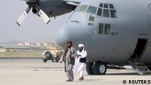 31.08.21 *** Taliban walk in front of a military airplane a day after the U.S. troops withdrawal from Hamid Karzai International Airport in Kabul, Afghanistan August 31, 2021. REUTERS/Stringer