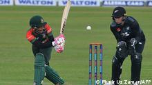 Bangladesh's Mushfiqur Rahim (L) plays a shot during the first Twenty20 international cricket match between Bangladesh and New Zealand at the Sher-e-Bangla National Cricket Stadium in Dhaka on September 1, 2021. (Photo by Munir Uz zaman / AFP)