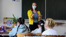 Pupils attend a lesson at their elementary school in Berlin on August 9, 2021, after coming back from summer holidays and amid the coronavirus COVID-19 pandemic.. - Berlin's pupils are to wear face masks during the first two weeks after the summerholidays in order to prevent the spreading of the coronavirus. (Photo by Tobias SCHWARZ / AFP) (Photo by TOBIAS SCHWARZ/AFP via Getty Images)