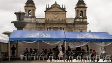 People wait for their first and second dose of the coronavirus vaccine at a temporary health center installed at Constitution square in Guatemala City, Wednesday, Aug. 25, 2021 (AP Photo/Moises Castillo)