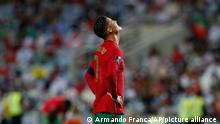 Portugal's Cristiano Ronaldo reacts during the World Cup 2022 group A qualifying soccer match between Portugal and the Republic of Ireland at the Algarve stadium outside Faro, Portugal, Wednesday, Sept. 1, 2021. (AP Photo/Armando Franca)