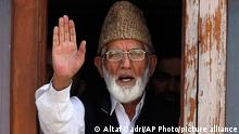 FILE - In this Wednesday, Sept. 8, 2010, file photo, Kashmiri separatist leader Syed Ali Shah Geelani waves to the media before his arrest in Srinagar, India. Geelani, an icon of disputed Kashmir's resistance against Indian rule and a top separatist leader who became the emblem of the region's defiance against New Delhi, died late Wednesday, Sept, 1, 2021. He was 92. (AP Photo/Altaf Qadri, File)