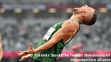 Algeria's ATHMANI Skander Djamil reacts after winning the Men's 400m - T13 Final at the Summer Paralympic Games in Tokyo on Sep. 2, 2021. ( The Yomiuri Shimbun via AP Images )