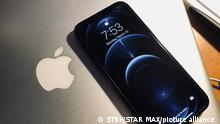 Photo by: STRF/STAR MAX/IPx 2021 3/15/21 iPhone 13 leak reveals that the fingerprint sensor and a smaller notch at the top. STAR MAX Photo: Here, an iPhone 12 pro with a large notch at the top of the screen.