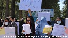 02.09.21 *** HERAT, AFGHANISTAN - SEPTEMBER 02: A group of women holding banners gather to stage a demonstration for their rights in Herat, Afghanistan on September 02, 2021. Mir Ahmad Firooz Mashoof / Anadolu Agency