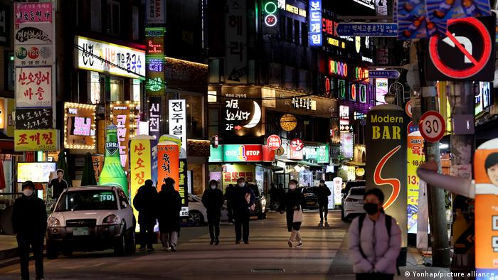 Bright neon lights at night along a street in the South Korean capital Seoul