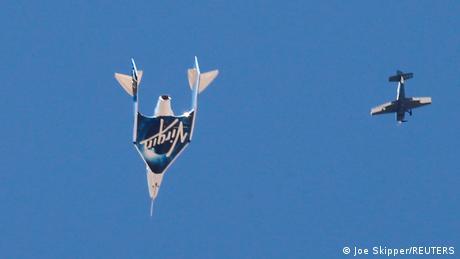 Virgin Galactic's passenger rocket plane VSS Unity, carrying billionaire entrepreneur Richard Branson and his crew, descends after reaching the edge of space
