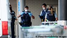 AUCKLAND, NEW ZEALAND - SEPTEMBER 03: Police guard the area around Countdown LynnMall where a violent extremist reportedly stabbed six people before being shot by police on September 03, 2021 in Auckland, New Zealand. A man has been shot dead by police after reportedly stabbing six people at LynnMall supermarket in Auckland. Prime Minster Jacinda Ardern has addressed the country describing the attack as violent and senseless. (Photo by Fiona Goodall/Getty Images)