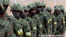 FILE PHOTO: Rwandan military troops depart for Mozambique to help the country combat an escalating Islamic State-linked insurgency that threatens its stability, at the Kigali International Airport in Kigali, Rwanda July 10, 2021. REUTERS/Jean Bizimana/File Photo