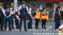 AUCKLAND, NEW ZEALAND - SEPTEMBER 03: Countdown LynnMall staff comfort each other as they wait to leave with police after a violent extremist took out a terrorist attack stabbing six people before being shot by police on September 03, 2021 in Auckland, New Zealand. A man has been killed by police after injuring multiple people in a mass stabbing incident at LynnMall supermarket in West Auckland. Prime Minster Jacinda Ardern has addressed the country describing the attack as violent and senseless. (Photo by Fiona Goodall/Getty Images)