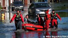 First responders pull local residents in a boat as they perform rescues of people trapped by floodwaters after the remnants of Tropical Storm Ida brought drenching rain, flash floods and tornadoes to parts of the northeast in Mamaroneck, New York, U.S., September 2, 2021. REUTERS/Mike Segar TPX IMAGES OF THE DAY