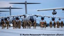 German Soldiers arrive on a plane from Tashkent, Uzbekistan at the Bundeswehr airbase in Wunstorf, Germany, Friday, Aug. 27, 2021, after they finished the evacuation mission in Kabul, Afghanistan. (AP Photo/Martin Meissner)