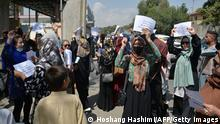 Afghan women take part in a protest march for their rights under the Taliban rule in the downtown area of Kabul on September 3, 2021. (Photo by HOSHANG HASHIMI / AFP) (Photo by HOSHANG HASHIMI/AFP via Getty Images)